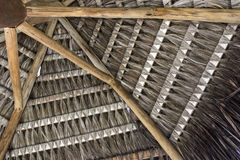 Tropical handmade coconut palm thatch roof for a beach kiosk in the summer Royalty Free Stock Photography