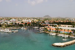 Tropical Harbor On Aruba. A view of the main harbor on Aruba looking inland. This photo, from a cruise ship, looks down over the city and boats stock photos