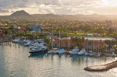 Tropical Harbor On Aruba in the gentle rays of the morning sun. Stock Photos