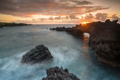 Magical Hawaiian sunrise on the Hana coast on the Island of Maui stock photo