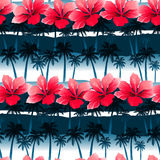 Tropical hibiscus flowers in a seamless pattern with blue palm t Stock Photos