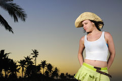 Tropical hispanic beauty on beach at sunset Stock Image