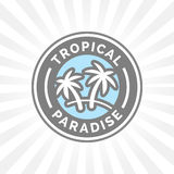 Tropical holiday paradise icon with palm trees symbol badge. Stock Photos