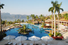 The tropical holiday resort. The tropical holiday hot spring resort with a swimming pool in the mountain,Guangzhou,Guangdong,China Stock Photos