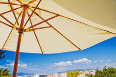 Beach umbrella, tropical holiday details. Tropical holiday resort destination withbeach umbrella over bright sky Stock Image