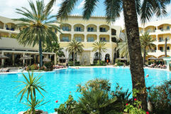 Tropical holiday resort - full of palms, with pool Stock Images