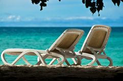 Tropical holidays. Two chairs at the beach in a tropical resort, Maldives Stock Photography