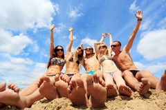 Tropical holidays. Cheerful young people having fun on a beach. Great summer holidays Royalty Free Stock Photos