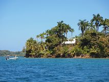 Tropical home on an island in the Caribbean sea Stock Photos