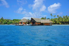 Tropical home over water French Polynesia Stock Photography
