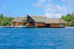 Tropical home over water Huahine French Polynesia Royalty Free Stock Images