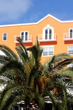 Tropical hotel. Hotel with palm trees house stock photo