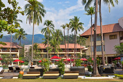 Tropical hotel c palms Royalty Free Stock Photography