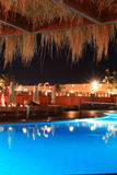 Tropical hotel at night(Sharm el Sheikh, Egypt). Recreational area in egyptian hotel at night Royalty Free Stock Photo