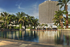 Tropical hotel Resort with swimming pool on a sunny day. Spending good time on vacation stock photos