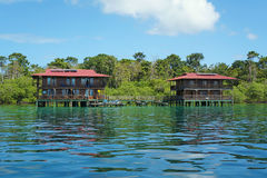 Tropical hotel on stilts over water Caribbean sea Stock Photos