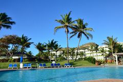 Tropical hotel with swimming pool. In foreground Royalty Free Stock Photos