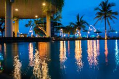 Tropical hotel with swimming pool at night with reflections and palms, Gili Trawangan, Lombok, Indonesia stock image