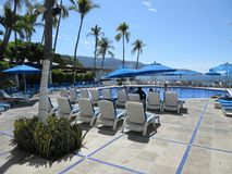 Tropical Hotel Swimming Pool. Photo of hotel swimming pool in acapulco guerrero mexico on 1/26/18.  The weather is warm even in january Stock Photography