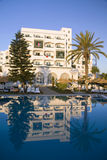 Tropical hotel - Tunisia, Africa. A beautiful tropical resort reflected in its own pool Stock Photo