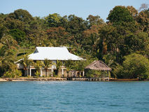 Tropical house on the beach with palapa Royalty Free Stock Image