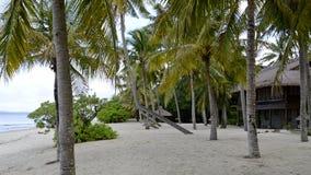 Tropical house on the beach. Stock Photo