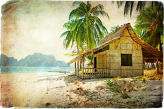 Tropical hut. Vintage styled picture - tropical island Stock Image