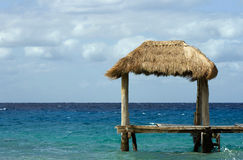 Tropical hut in ocean Royalty Free Stock Images