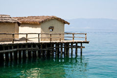 Tropical huts. View on pile-dwelling settlement in Macedonia Royalty Free Stock Image