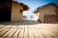 Tropical huts. View on pile-dwelling settlement in Macedonia Stock Photo
