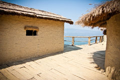 Tropical huts. View on pile-dwelling settlement in Macedonia Royalty Free Stock Photo