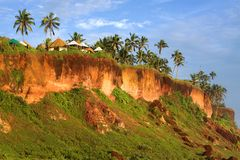 Tropical Huts on a Clifftop Stock Image