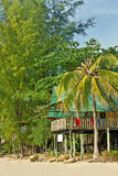 Tropical huts on stilts Stock Photography