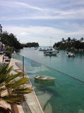 Tropical inlet, boats and palmtrees stock photography