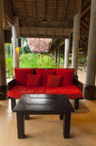 Tropical interior style. Red seat in veranda  and natural background scene Royalty Free Stock Photos