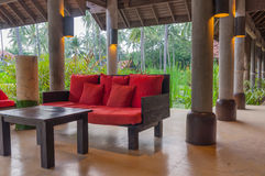 Tropical interior style. Red seat in veranda  and natural background scene Royalty Free Stock Photo