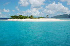 Tropical Island. Warm, sunny tropical island and blue water Stock Images