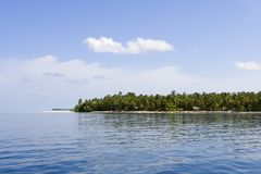Tropical island. From ocean side stock images