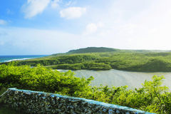 Tropical Island. A tropical island surrounded by ocean stock photography