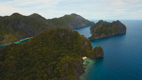 Tropical island, aerial view. El Nido. Tropical island, aerial view. Aerial view: sea and the tropical islands. Tropical bay in El Nido. Archipelago El Nido stock video