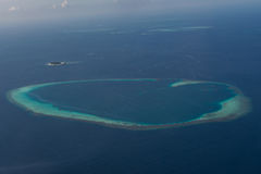 Tropical island arial view from seaplane at Maldives Stock Image