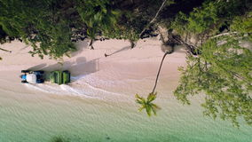 Tropical island beach and Beach Sand Cleaning Truck, aerial view.  stock video