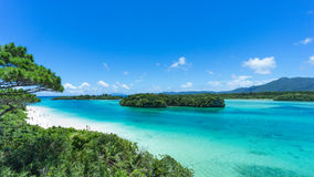 Tropical island beach and clear blue lagoon, Okinawa, Japan. Tropical island beach and clear blue lagoon, Ishigaki Island National Park of the Yaeyama Islands royalty free stock photo