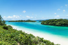 Tropical island beach and clear blue lagoon, Okinawa, Japan Stock Image