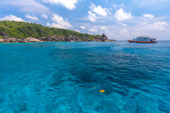 Tropical island beach and clear blue lagoon water with blue sky at Similan Island, Phang Nga Province, South of Thailand Stock Images
