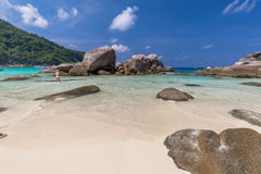 Tropical island beach and clear blue lagoon water with blue sky at Similan Island, Phang Nga Province, South of Thailand Stock Photos