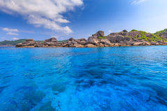 Tropical island beach and clear blue lagoon water with blue sky at Similan Island, Phang Nga Province, South of Thailand Royalty Free Stock Photography