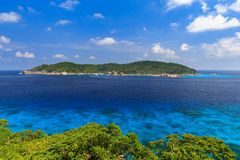 Tropical island beach and clear blue lagoon water with blue sky at Similan Island, Phang Nga Province, South of Thailand Royalty Free Stock Photos