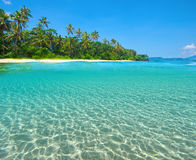 Tropical Island Beach with the half underwater view with sea bed Stock Photo