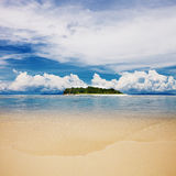 Tropical island beach with perfect sky Stock Photos